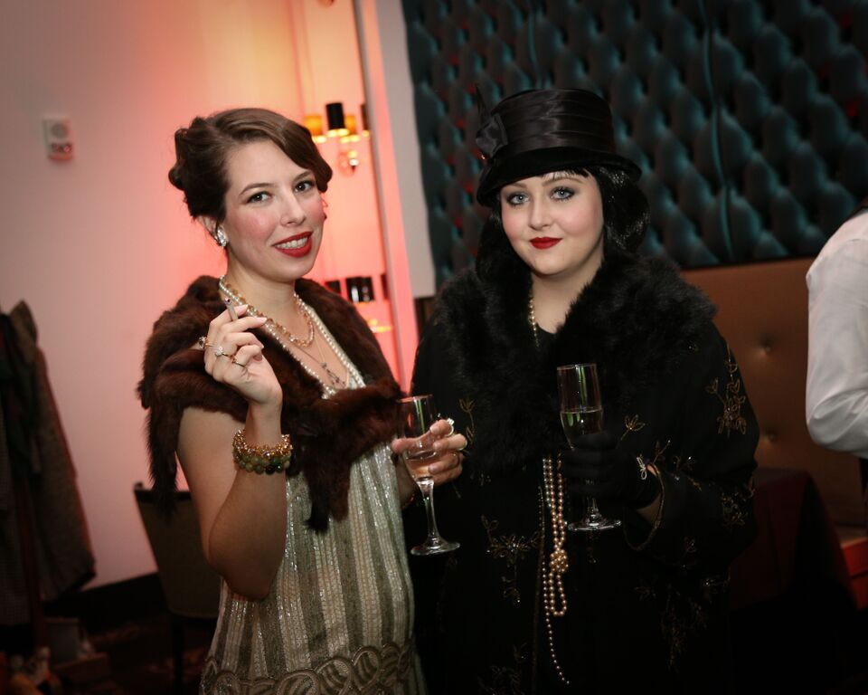 The dinner party came alive with relics of the roaring twenties. Flapper dresses, pearls, pinstripes, fur coats!
