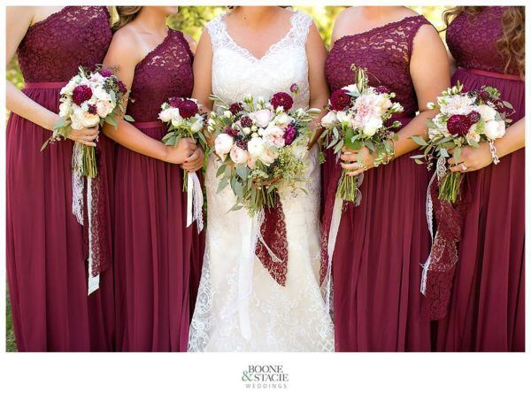 Bride and Bridal party posing with their bouquets