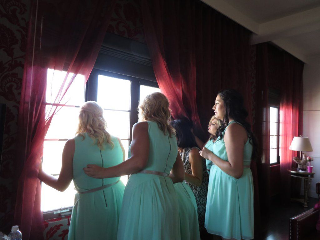 This is such a cute photo, the bridal party and Patty MOB are watching all of the guests arrive.