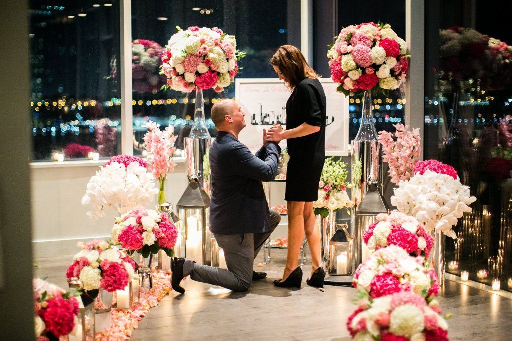 How Mike proposed to Candace with an intimate New York floral rooftop proposal at Ink48 and planned by The Heat Bandits Photo credit: © Petronella Photography http://bypetronella.com