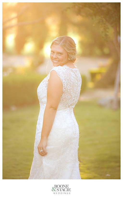Fairy Godmother Bride Natalie Agee striking a pose during first look.