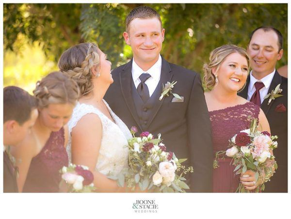 Bride and groom captured laughing candidly during group photos.