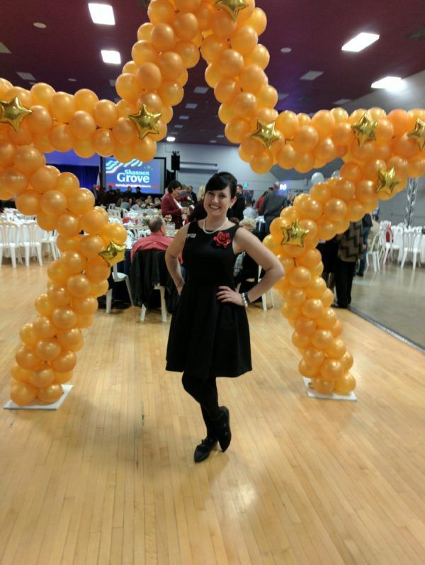 Fairy Godmother Cassandra in front of the Paradise Balloon Designs balloon arch at the Shannon Grove for Senate launch.