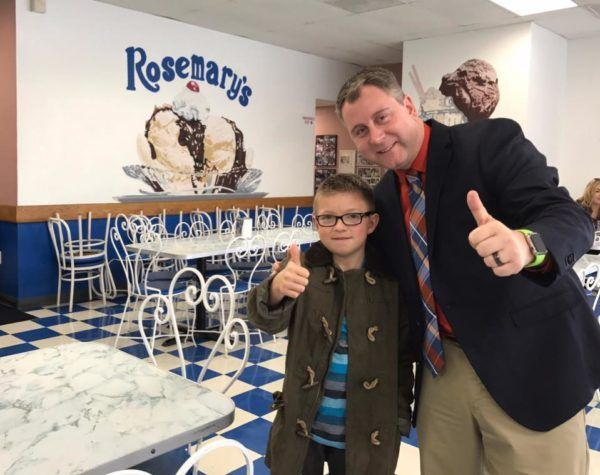 Thumbs Up, Cancer Down founder Kevin Charette with Issac.